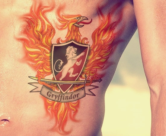 man-with-harry-potter-gryffindor-phoenix-sword-tattoo-on-ribs